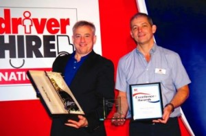 Andrew Padgett (R), Driver Hire Canterbury franchisee receiving award from Chris Chidley (L), CEO.