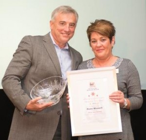 Diane Maxwell receiving an award from CEO Chris Chidley earlier in the year.