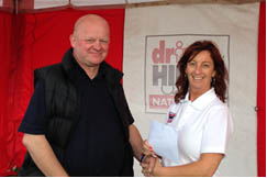 Driver receives his prize from Driver Hire Newcastle's Janet Lambert