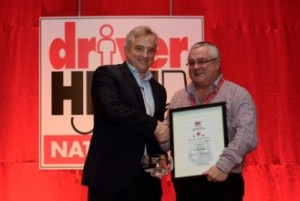 Driver Hire's CEO Chris Chidley (L) presents Richard Pugh (R) with an award at the Driver Hire 2016 Winter Conference.